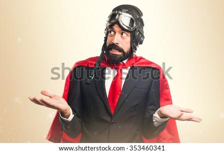 Super hero businessman making unimportant gesture - stock photo