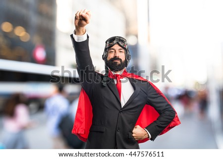 Super hero businessman on unfocused background
