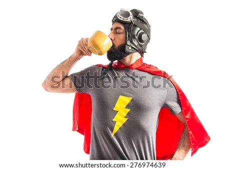 Super hero holding a cup of coffee