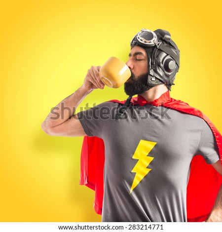 Super hero holding a cup of coffee over colorful background