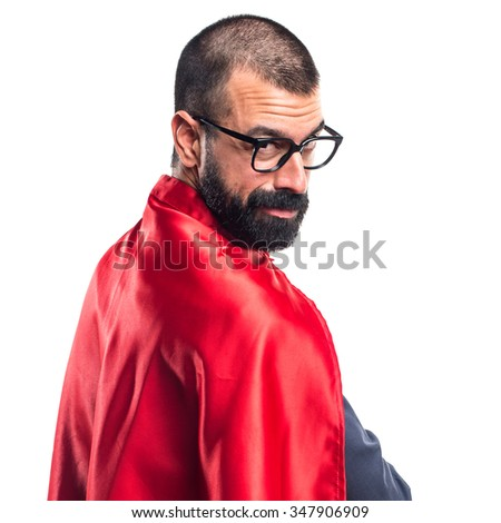 Super hero with his arms crossed - stock photo