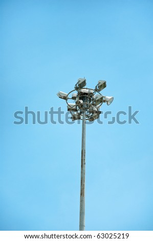 Super highway lighting column with blue sky. - stock photo