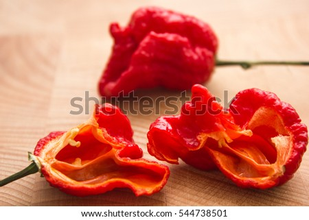 Super hot pepper on wooden table