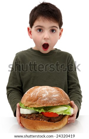 Super huge giant burger for a very hungry boy. - stock photo