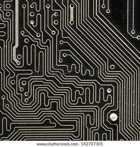 Super macro of electronic material inside computer. - stock photo