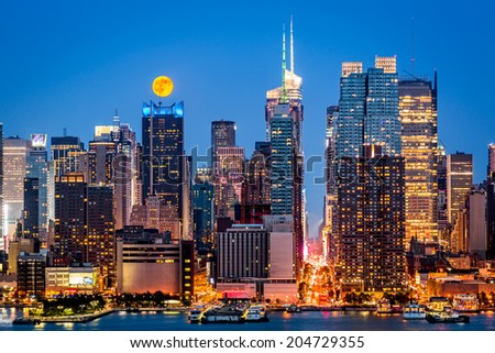 Super Moon rise above the midtown Manhattan skyline on July 12, 2014 - stock photo