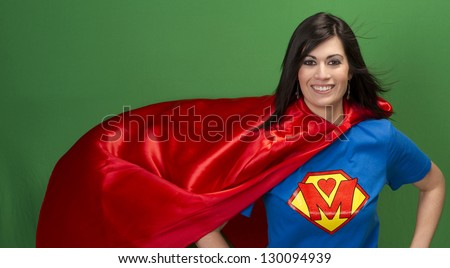 Super Mother Hero in Red Cape With Chest Crest Smiling - stock photo
