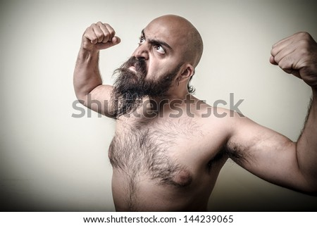 super power angry muscle bearded man  on gray background