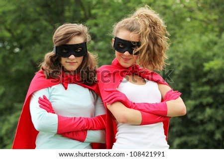 Super team of super hero girl with red cape and red gloves - stock photo