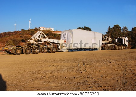 Super unique long truck loading windmills - stock photo