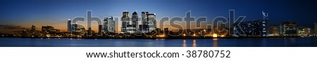 Super wide Panorama of the Canary Wharf area at sunset, London. - stock photo