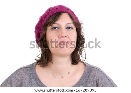 Supercilious disdainful woman in a knitted purple beanie sneering at the camera with a scornful look, head and shoulders on white - stock photo