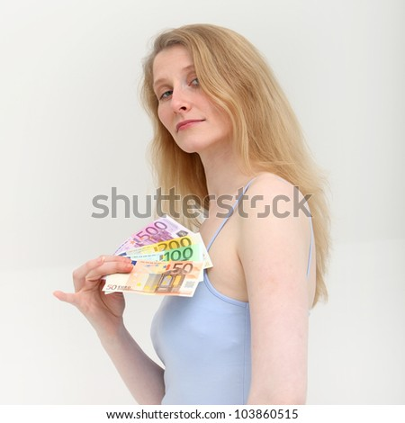 Supercilious woman taking a payoff Supercilious woman holding a fan of euro denominated cash in her fingers taking a payoff or backhander for services rendered or for facilitating a deal - stock photo
