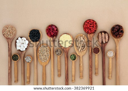 Superfood for good health in wooden spoons forming an abstract background with copy space. High in antioxidants, vitamins and minerals. - stock photo