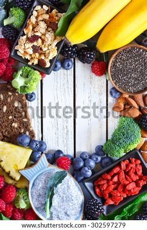 Superfood. Frame of healthy vegan ingredients on white wooden board.