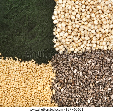 superfoods heap pile collection close up surface top view:  spirulina, quinoa, amaranth, chia