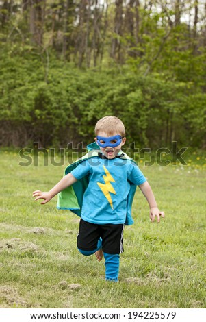 Superhero!  Adorable little boy dressed as a superhero. - stock photo