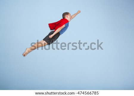 Superhero boy on blue background