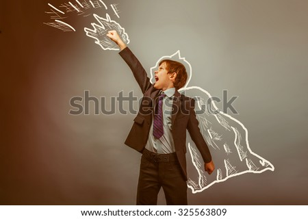 superhero boy raised his hands superpower businessman flying behind a cloak photo studio teenager retro - stock photo