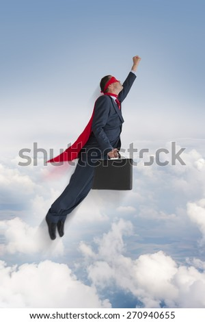 superhero businessman flying upwards in the sky - stock photo