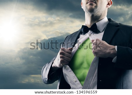 Superhero businessman pulls open shirt. Green Power - stock photo