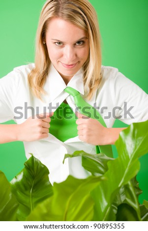 Superhero Businesswoman confident face green plants emerges from shirt - stock photo