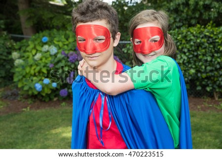 Superhero duo in cape and mask