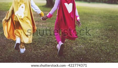 Superhero Girls Friendship Cute Happiness Fun Playful Concept - stock photo
