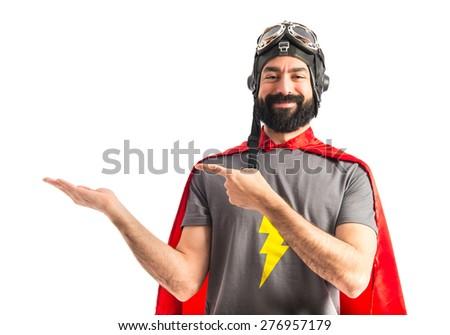 Superhero holding something  - stock photo