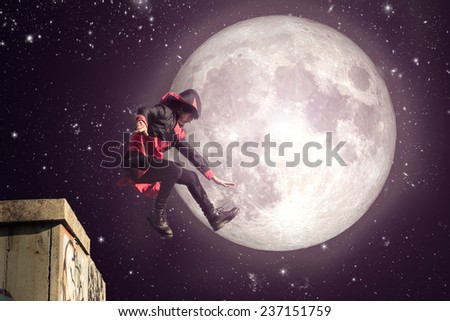 superhero jump from a building to rescue some innocents. concept about parkour and fantasy - stock photo
