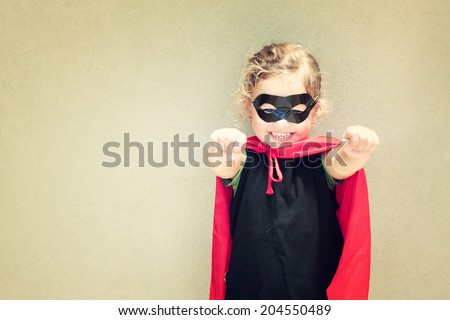 Superhero kid against textured wall background.  playing activity concept . kids homemade costume. toned image. - stock photo