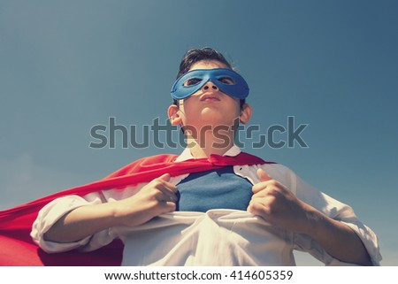 Superhero kid concept. Retro toned image with selective focus - stock photo
