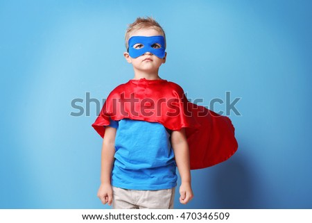 Superhero kid on blue background