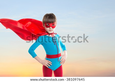 Superhero Kid on sunset sky background.