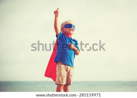 Superhero Kid, Young Happy Boy Playing  - stock photo