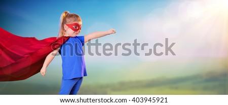 Superhero Little Girl Against Light In The Sky - stock photo