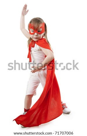 Superhero little girl in a red raincoat and a mask - stock photo