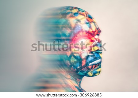 Superhero portrait, colorful face art with motion blur effect. - stock photo