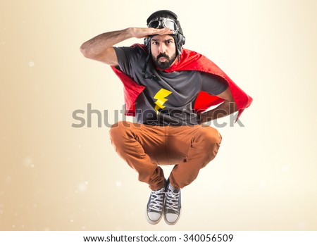 Superhero showing something