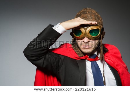 Superman concept with man in red cover - stock photo