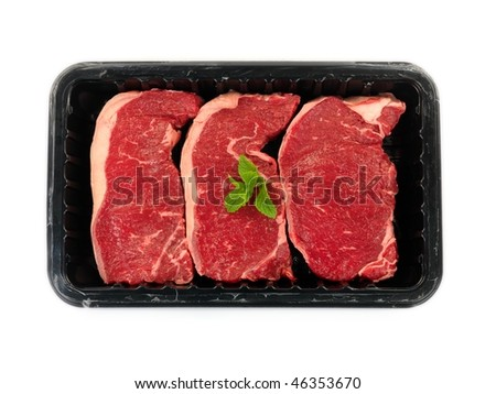 Supermarket packaged porterhouse steaks isolated against a white background