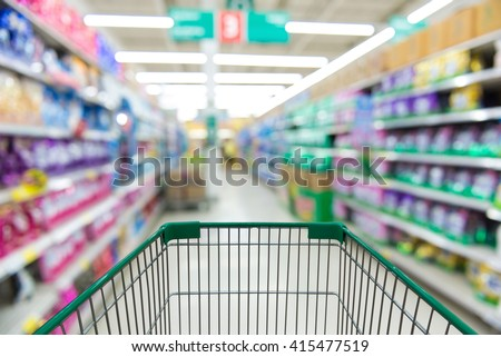 supermarket shopping cart view with blackground blur - stock photo