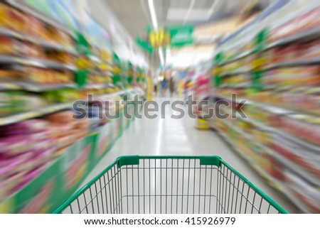 supermarket shopping cart view with motion blur - stock photo