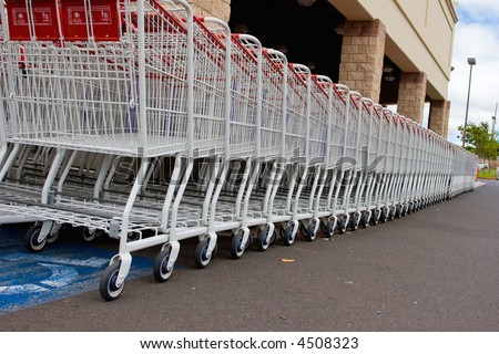 Supermarket shopping carts outside waiting to be used - stock photo
