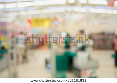 Supermarket store blur background ,Cashier counter with customer - stock photo
