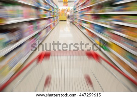 supermarket with a shopping cart background - stock photo