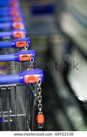 supermatket trolleys (shallow DOF) - stock photo