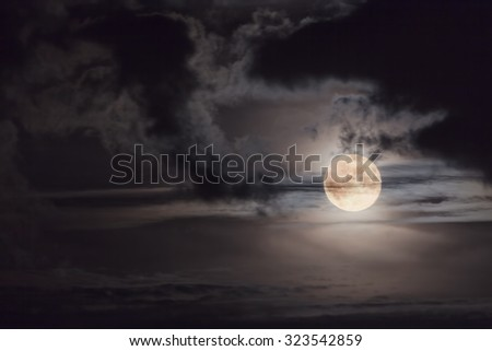 Supermoon background, night sky with full moon and beautiful clouds in soft focus - stock photo