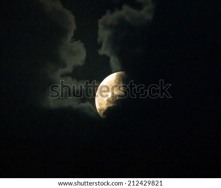 Supermoon on August 10th 2014, partly hidden behind clouds. - stock photo