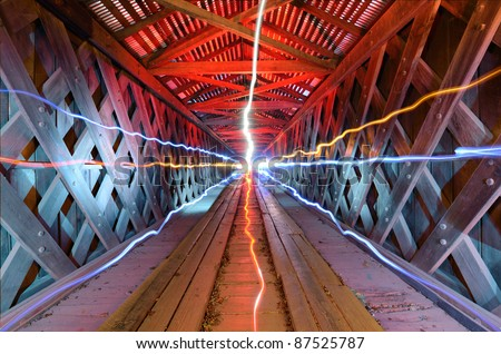 supernatural light inside of a wooden tunnel - stock photo